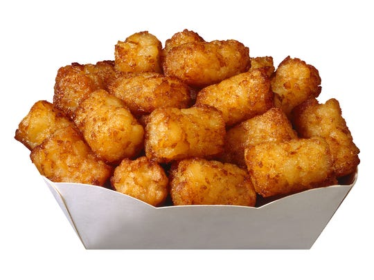 A container of delicious, crispy tater tots.