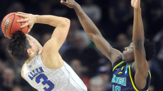 Grayson Allen, left, and Duke battled Devontae Cacock and UNC-Wilmington the last time March Madness came to Rhode Island in 2016.