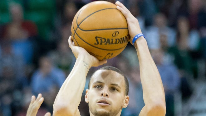 Golden State Warriors point guard Stephen Curry (30) shoots the ball during the first half against the Utah Jazz.