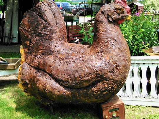 This funky plastic foam chicken, about six feet tall,