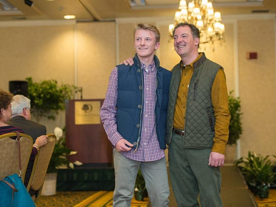 Cliff Deetjen, right, architectural designer at Peregrine Build/Design, poses with his son, Ben, in fashions from Spellbound at fashion show.