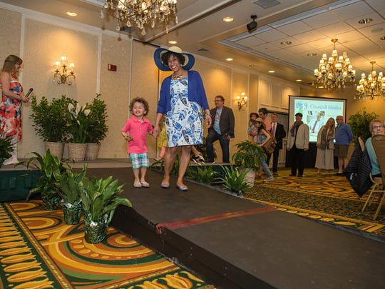 Kendra Barber-Smith and her son Jonesy, a Family Room family, strut the runway at the 2016 Spring Blooms! Fashion Show.
