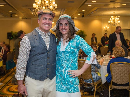 Brian Boardman, Realtor at Coldwell Banker Hickok & Boardman Realty, and his daughter Lilly model fashions from Orvis and Sportstyle at the 2016 Spring Blooms! Fashion Show.