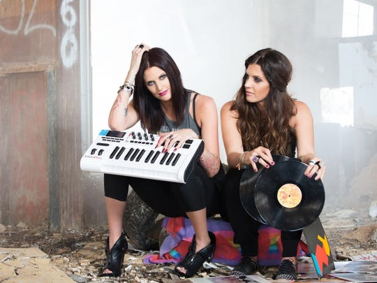 Musician and songwriter Esjay Jones (left) and her girlfriend, DJ Shasta Sowards, collaborate Girls Gone Vinyl, an event at the Hard Rock Hotel in Palm Springs.