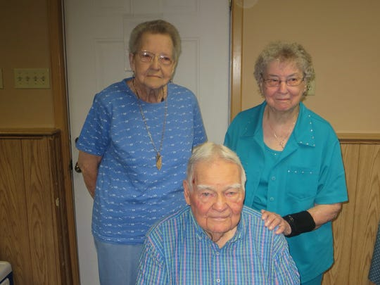 Helen Roeder and Margie Roeder, standing, and John Sander, seated have been participating in the annual Labor Day gathering since the beginning -- 70 years ago.