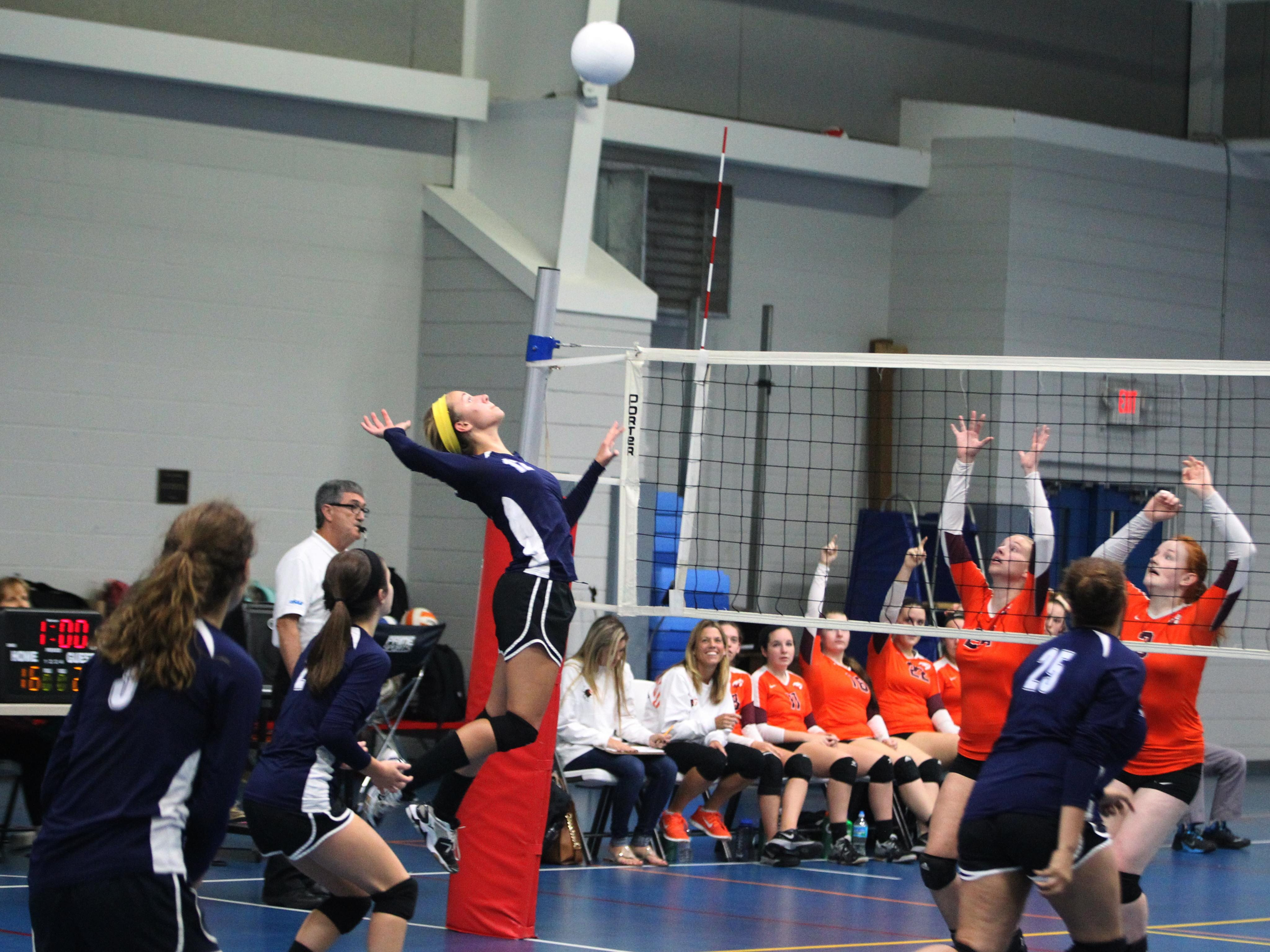 Community Christian sophomore Abbie Post goes for a vicious kill in a game against Christ's Church Academy.