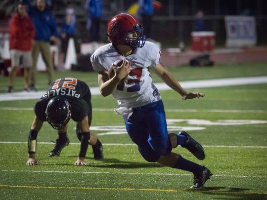 St. Clair's Ben Davidson runs the ball during a football game Friday, September 30, 2016 at East China Stadium.
