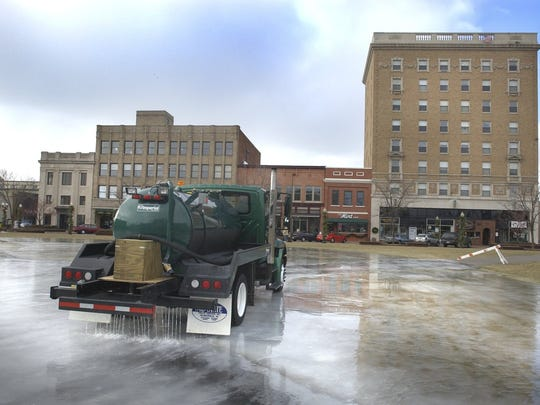 In this 2005 file photo, the parks department sprays water on The 400 Block in the downtown area to prepare the skating rink.