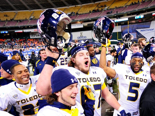 Toledo players celebrate after beating Air Force in