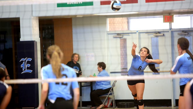 Enka's Sarah Smith serves during Saturday's 3-0 home win over Anson County.