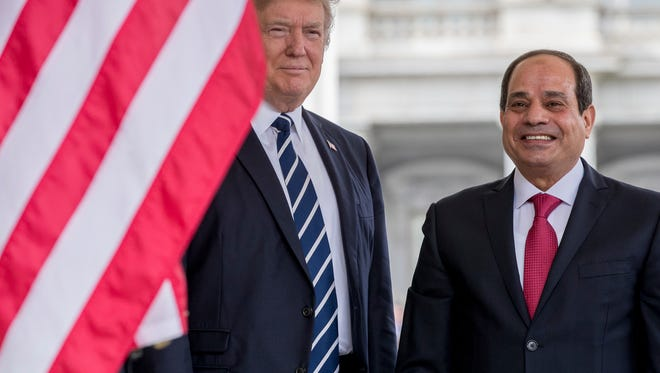 President Trump greets Egyptian President Abdel Fattah Al-Sisi.