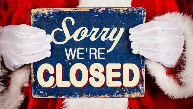 Santa with closed sign