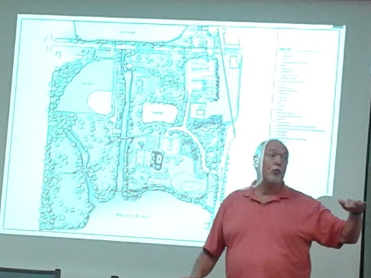 Milford resident Gary Krebs makes a point about a proposed plan for a canoe launch in Central Park.