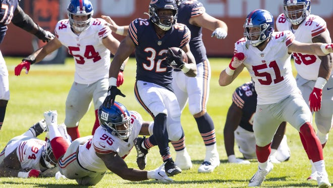 Chicago Bears running back David Montgomery (32) runs against New York Giants linebacker Kyler Fackrell (51) in the fourth quarter Sunday, at Soldier Field. The Bears defeated the Giants, 17-13.