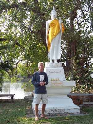 Steven Fallon of Warren took the D to the Sukhothai Historical Park in Sukhothai, Thailand, in February 2017. He is photographed in front of Wat Phra Mahathat Buddha. While he was there, the monks near the statue explained that the position of the hand signifies driving away fear.