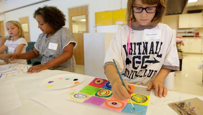Shalyn Uselmann paints at the LEAPS program at UW-Fond du Lac Tuesday.