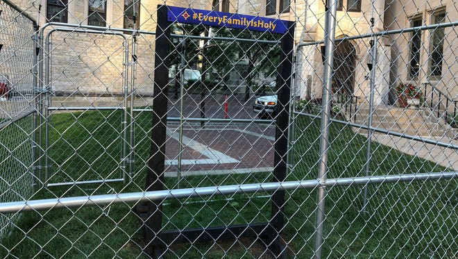 Christ Church Cathedral in Indianapolis updated its protest against the Trump administration's zero-tolerance immigration policies that separate families by replacing the Holy Family with a mirror to encourage self-reflection, as seen Thursday, July 26, 2018.