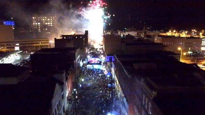 An aerial photo shows a large crowd at the New Year's party to ring in 2016 outside Social on State in downtown Binghamton.
