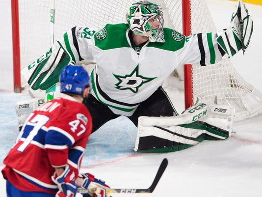 Dallas Stars goalie Kari Lehtonen (32) makes a glove save on Montreal Canadiens right wing Alexander Radulov (47) during the second period of an NHL hockey game in Montreal on Tuesday, March 28, 2017. (Ryan Remiorz/The Canadian Press via AP)