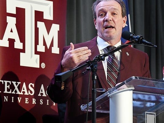 FILE - In this Dec. 4, 2017, file photo, Jimbo Fisher speaks as he is introduced as Texas A&M's new head football coach, in College Station, Texas. A potential new tax on seven-figure salaries for employees of non-profits hasn't deterred schools from doling out huge contracts to new coaches. Football powers aiming for a national title have continued to pay the market rate for proven coaches, topped by the 10-year, $75 million deal for Jimbo Fisher at Texas A&M. (Dave McDermand/College Station Eagle via AP, File)/College Station Eagle via AP)