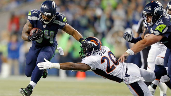 """Seattle Seahawks running back Thomas Rawls carries the ball as Denver Broncos defensive back Josh Bush attempts a tackle in the second half of a preseason NFL football game in Seattle. """"He's done very well and been consistent,"""" Seahawks coach Pete Carroll says of Rawls. """"Whenever he's been given a real good shot, he's come through in a big way."""" The Seahawks face the Pittsburgh Steelers this week."""