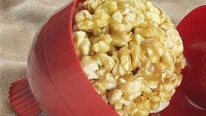 Butter up small hands to help children make popcorn balls in the kitchen on winter break.