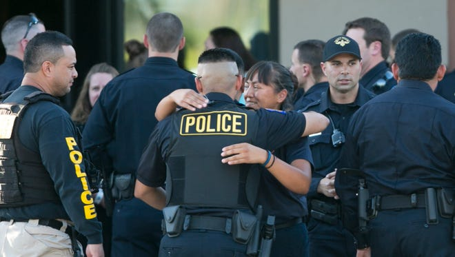 Officers from many law-enforcement agencies gather at a public visitation to honor slain Officer Jair Cabrera at West Resthaven Funeral Home on  May 29, 2014.