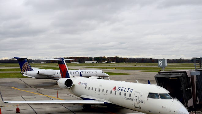 Officials at Capital Region International Airport suggest travelers check the airport's website for possible delays caused by the blizzard affecting the eastern U.S.
