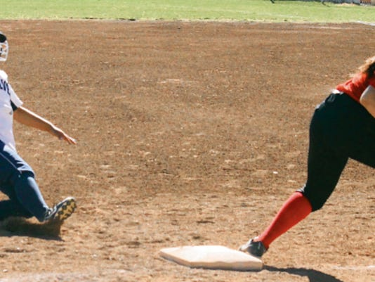 Danny Udero/Sun-News   Silver's McKayla Guerra slides safely into third base during action against Hatch Valley.