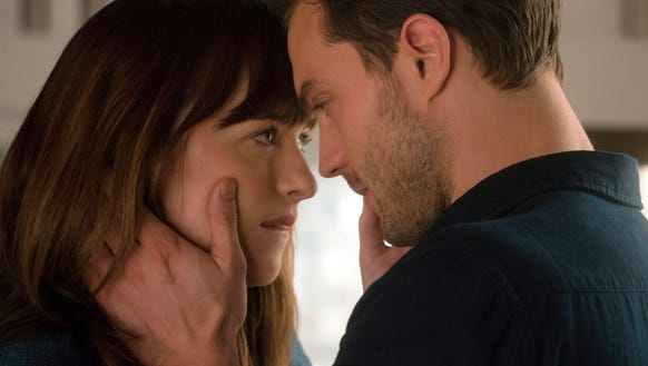 Dakota Johnson as Anastasia Steele, left, and Jamie