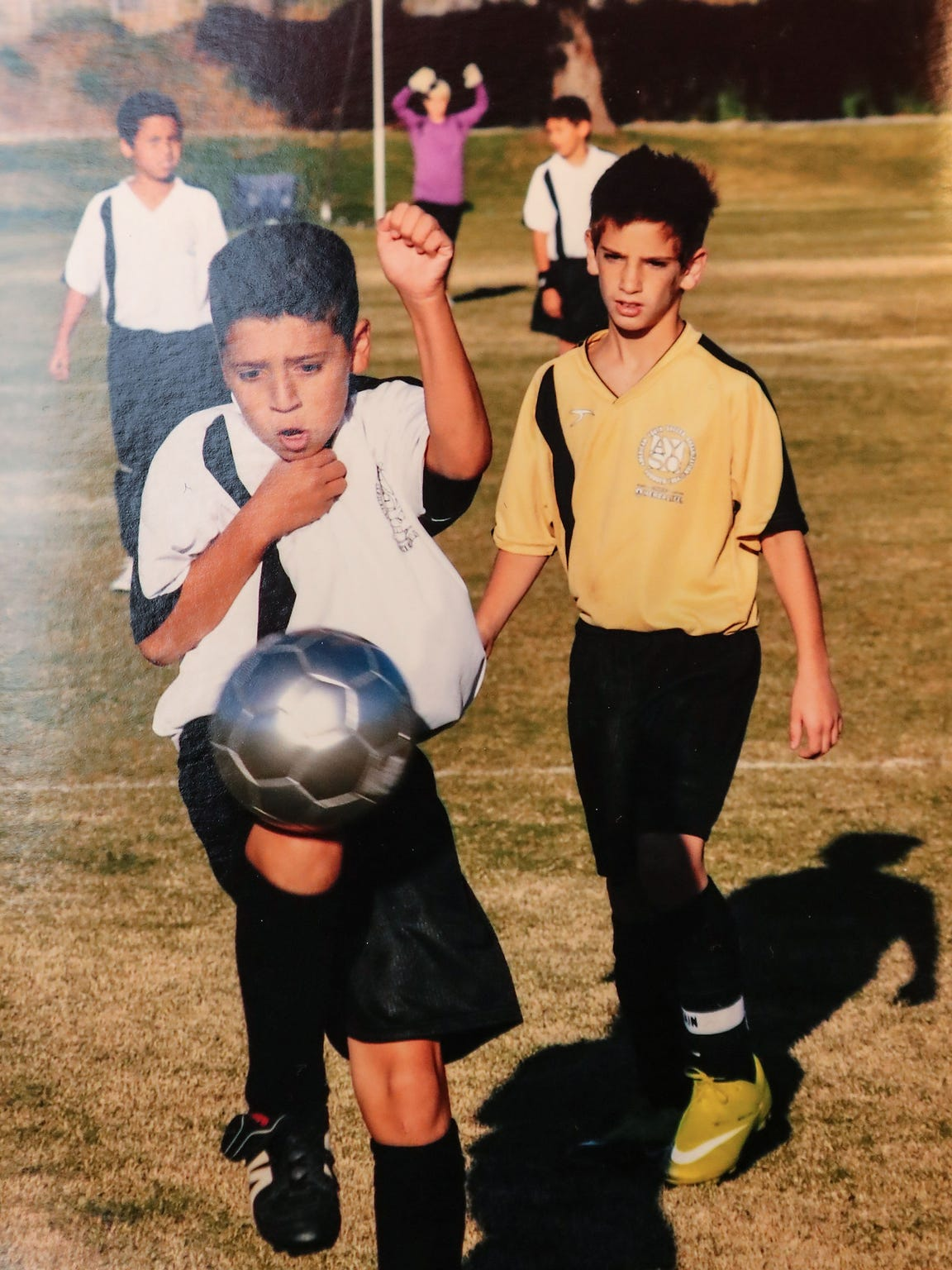 Kevin Salamone, left, started playing soccer in his
