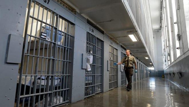 A guard checks on inmates at the state penitentiary.