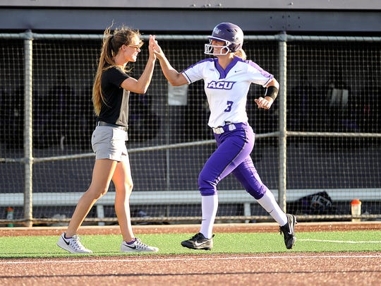 Abilene Christian's Peyton Hedrick (3) is congratulated after hitting a 2-run home run in the bottom of the fifth inning of the Wildcats' 6-2 win on Wednesday, April 19, 2017, at ACU's Poly Wells Field.