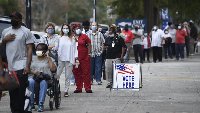 Voters wait in line Oct. 12 to cast their ballots early at the Bell Auditorium in Augusta. The Bell and three other Augusta locations will be open for Saturday voting and through next week. Sunday voting will be held at the Bell.