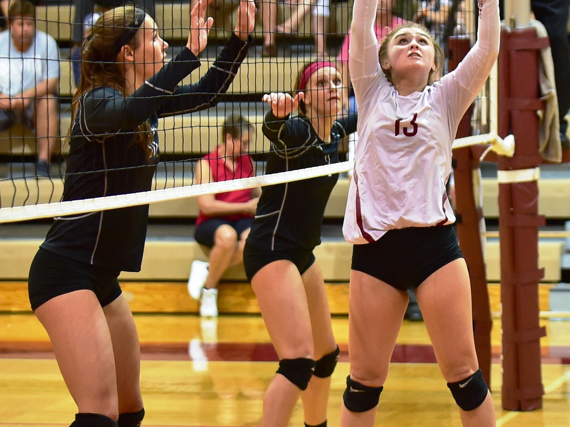 Milford setter Mya Zeese (right) had a career-high 45 assist-to-kills in a 3-1 KLAA West victory over Brighton.