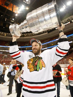 Defenseman Nick Boynton lifts the Stanley Cup after the Chicago Blackhawks' 2010 championship.