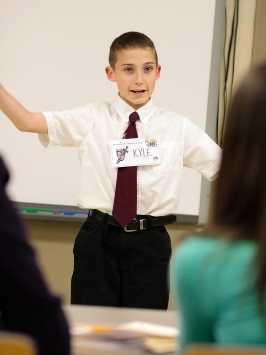 OCCA's Kyle Kozak (4th grade) presents his poem to the judging panel at Frid.jpg