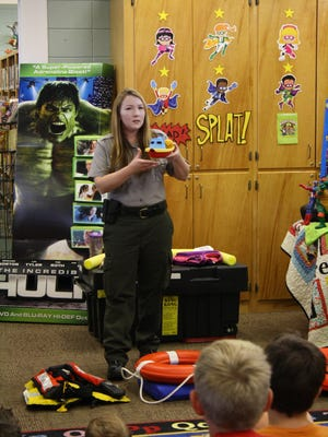 Army Corps of Engineers natural resources specialist Kathleen Payne, shown, presents a water-safety demonstration for the Wednesday Heroes program at the Marion County Library. Payne entertained participating children, along with teaching them about rules and safety tips for enjoying area rivers and lakes.