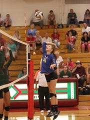 Clyde's Morgan Bannister prepares for the kill against the Oak Harbor Rockets.