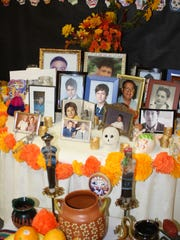 A Día de los Muertos altar at Cathedral High School has pictures of deceased students, faculty and community members.