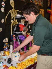 Jason Creighton helps set up an altar at Cathedral High School.