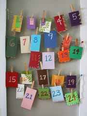 Make your own Advent calendar with envelopes, clothes pins and twine.