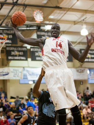 Athlete Institute's Thon Maker (14) grabs a rebound during the basketball game vs Potter's House at the City of Palms Classic in Fort Myers, FL on Sunday, December 20, 2015.  Potter's House Lions are from Jacksonville, FL and the Athlete Institute Bears are from Orangeville, Ontario.  Thon Maker, a 7-foot-1 senior center from Sudan, has been in America for about six years and played at about that many schools. For the past two years, he has been in Canada.