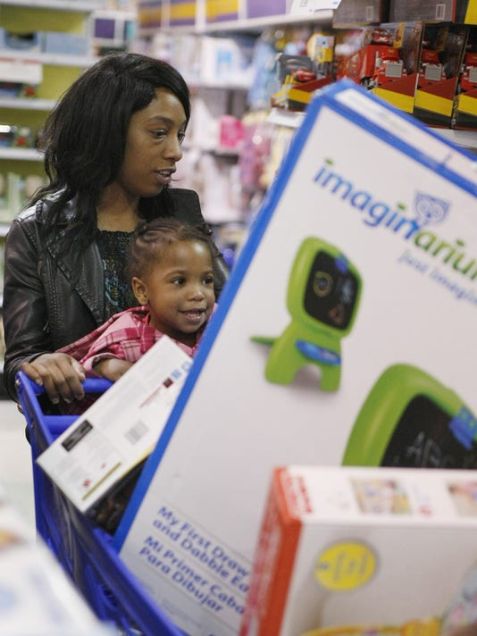 asb 1124 holiday shopping artyse esannason 23 of neptune shops with her daughter isis smith 23 months at the toys r us in eatontown tuesday