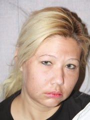 A photograph taken by Phoenix police of Rebekah Mellon shortly after her arrest on suspicion of shooting her husband on July 31, 2012. Rebekah Mellon passed out in a police car while waiting to be questioned, police said.