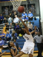 Clarksville Academy's Sydneey Boykin tries to lay the