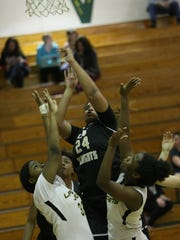 A Kenwood player puts up a shot between two Springfield