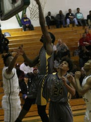 Northeast's Rasean Taylor goes up for a shot against