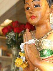 A tiny shrine near Sontaya's cash register honors Sontaya's