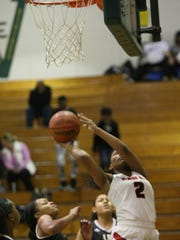 Rossview's Semajia Ogburn goes up for a shot after